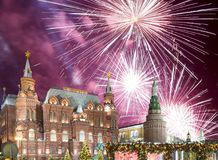 Fireworks over the Christmas New Year holidays illumination and State Historical Museum inscription in Russian,Moscow, Russia Royalty Free Stock Photos