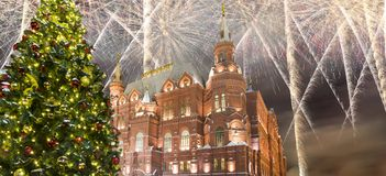 Fireworks over the Christmas New Year holidays illumination and State Historical Museum inscription in Russian,Moscow, Russia. Fireworks over the Christmas New Stock Images