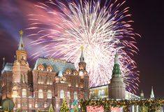 Fireworks over the Christmas New Year holidays illumination and State Historical Museum inscription in Russian,Moscow, Russia. Fireworks over the Christmas New Stock Photos