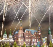 Fireworks over the Christmas New Year holidays illumination and State Historical Museum inscription in Russian,Moscow, Russia Royalty Free Stock Photography