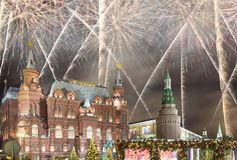 Fireworks over the Christmas New Year holidays illumination and State Historical Museum inscription in Russian,Moscow, Russia Stock Photo