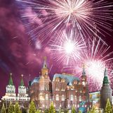 Fireworks over the Christmas New Year holidays illumination and State Historical Museum inscription in Russian,Moscow, Russia Royalty Free Stock Images