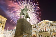 Fireworks over the Christmas and New Year holidays illumination. Yury Dolgoruky  Monument, Russia. Fireworks over the Christmas and New Year holidays Royalty Free Stock Images