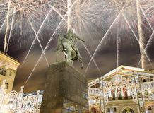 Fireworks over the Christmas and New Year holidays illumination. Yury Dolgoruky  Monument, Russia. Fireworks over the Christmas and New Year holidays Royalty Free Stock Image