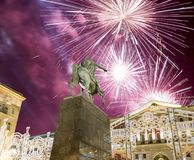 Fireworks over the Christmas and New Year holidays illumination. Yury Dolgoruky  Monument, Russia. Fireworks over the Christmas and New Year holidays Royalty Free Stock Photography