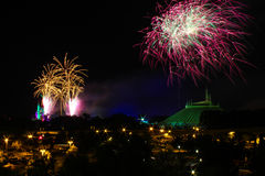 Fireworks over Cinderella's Castle and Space Mountain. Royalty Free Stock Images