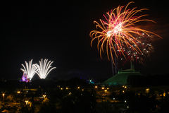 Fireworks over Cinderella's Castle and Space Mountain. View of Fireworks being set off over the Magic Kingdom and Space Mountain in Orlando, Florida Royalty Free Stock Image