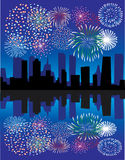 Fireworks over city. With reflection Royalty Free Stock Image