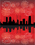 Fireworks over city. White, red and yellow fireworks above the city Stock Photo