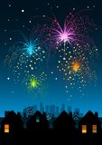 Fireworks over the City. Fireworks display over a city and houses Royalty Free Stock Photography