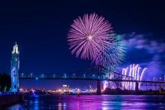 Fireworks over city bridge in Montreal stock image