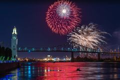 Fireworks over city bridge in Montreal stock photography