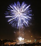 Fireworks over city buildings Royalty Free Stock Photography
