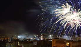 Fireworks over the city. Royalty Free Stock Image