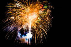 Fireworks over the city celebrate in happy festival. Stock Photos