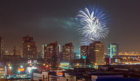Fireworks over the city. Fireworks over a modern night European city Royalty Free Stock Image