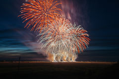 Fireworks over the city. Multi-colored fireworks against the background of the sunset sky. stock photography