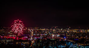 Fireworks over the city in the New Year. Almaty, Kazakhstan Royalty Free Stock Photography