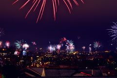 Fireworks over city at night Royalty Free Stock Images