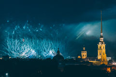 Fireworks over the city of St. Petersburg Russia on the feast of `Scarlet Sails`. In the rain with fog and smoke Stock Image