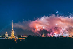Fireworks over the city of St. Petersburg Russia on the feast of `Scarlet Sails`. In the rain with fog and smoke Royalty Free Stock Images