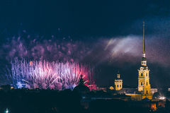 Fireworks over the city of St. Petersburg Russia on the feast of `Scarlet Sails`. In the rain with fog and smoke Stock Photo