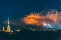 Fireworks over the city of St. Petersburg Russia on the feast of `Scarlet Sails`. In the rain with fog and smoke Stock Photography