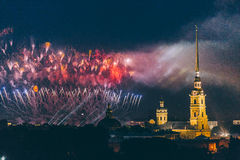 Fireworks over the city of St. Petersburg Russia on the feast of `Scarlet Sails`. In the rain with fog and smoke Stock Images