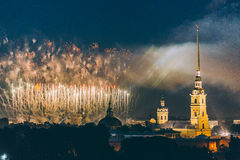 Fireworks over the city of St. Petersburg Russia on the feast of `Scarlet Sails`. In the rain with fog and smoke Royalty Free Stock Photography