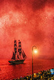 Fireworks over the city of St. Petersburg (Russia). ST.PETERSBURG, RUSSIA - JUN 20, 2015: Light show and firework with a frigate with scarlet sails floating on Royalty Free Stock Photography