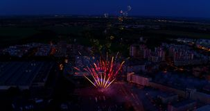 Fireworks over city, taken from aerial perspective stock footage