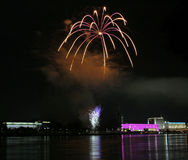 Fireworks over the danube in Linz, Austria #1. Fireworks in Linz (Austria) at the Danube river with beautiful reflections. On the right side the Brucknerhaus ( Royalty Free Stock Photo