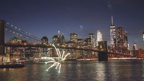Fireworks over downtown manhattan New York City of fireworks and starry sky city blurred lights stock video footage