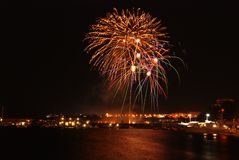 Fireworks over the harbor. A background of fireworks in the night sky stock image