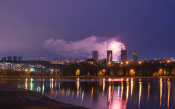 Fireworks over the lake, the city`s night skyline, Royalty Free Stock Photos