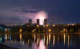 Fireworks over the lake, the city`s night skyline, Royalty Free Stock Photography