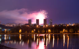 Fireworks over the lake, the city`s night skyline, Stock Photo