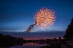 Fireworks Over Lake at Night. Stock Photos