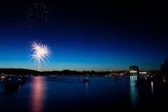 Fireworks over Lake at Twilight Stock Photo