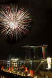 Fireworks over Merlion Park. Fireworks launched on water of Marina Bay, Singapore, NDP2010 with marina bay sand in the background Stock Images