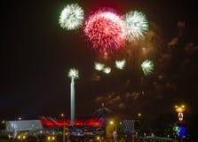 Fireworks over Minsk, Belarus. Minsk, Belarus - May 9, 2014: Victory Day fireworks and celebrations near obelisk Stella Minsk City-Hero stock image