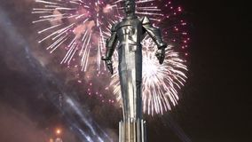 Fireworks over the Monument to Yuri Gagarin 42.5-meter high pedestal and statue, the first person to travel in space. Moscow. Fireworks over the Monument to Yuri stock video footage
