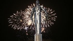Fireworks over the Monument to Yuri Gagarin 42.5-meter high pedestal and statue, the first person to travel in space. Moscow. Fireworks over the Monument to Yuri stock video