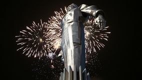 Fireworks over the Monument to Yuri Gagarin 42.5-meter high pedestal and statue, the first person to travel in space. Moscow. Fireworks over the Monument to Yuri stock footage