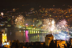 Fireworks over the night a beautiful city Stock Image