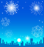 Fireworks over the night city. Background Stock Photos