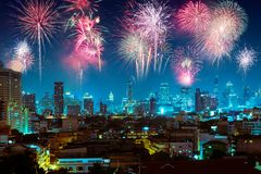 Fireworks over night city for happy new year celebration.  Royalty Free Stock Images