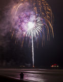 Fireworks over a pier Royalty Free Stock Images
