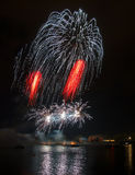 Fireworks over river Stock Photography