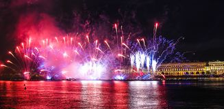 Fireworks over the river. Bright laser show. Holiday in the city. Summer performance stock image